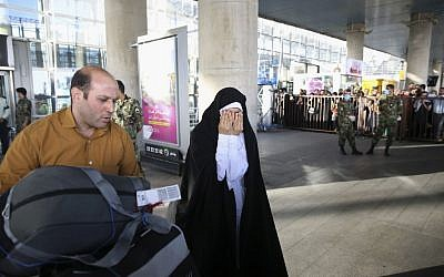 A female Iranian hajj pilgrim weeps after meeting relatives upon her arrival at Tehran Imam Khomeini airport, Iran, Tuesday, September 29, 2015. (AP/Vahid Salemi)