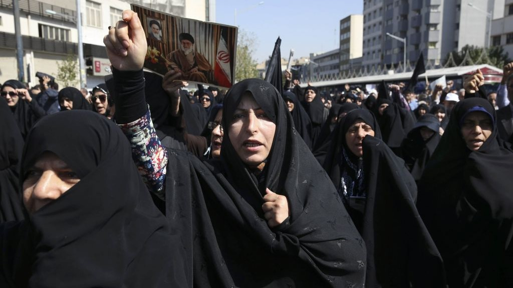 Iranian worshipers chant slogans while attending an anti-Saudi protest rally in Tehran, Iran, Friday, Sept. 25, 2015 (AP Photo/Vahid Salemi)