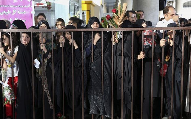 Iranians wait for their relatives from the hajj pilgrimage in Saudi Arabia, at the Tehran Imam Khomeini airport, Iran, Tuesday, Sept. 29, 2015. More than 700 pilgrims were killed on Thursday in a stampede during the final days of the annual hajj in Mina near the holy city of Mecca, Saudi Arabia. The disaster killed at least 239 Iranian pilgrims, while over 200 people remain missing, Iran's state television reported. (AP/Vahid Salemi)