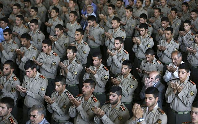 Iranian army cadets perform their Friday prayer at the Tehran university campus, Friday, Sept. 25, 2015.  (AP Photo/Vahid Salemi)