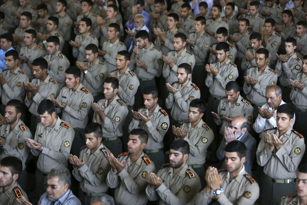 "Iranian army cadets perform their Friday prayer at the Tehran university campus, Friday, Sept. 25, 2015. Thousands of Iranian worshippers have marched in Tehran after Friday prayers to denounce the ""incompetency"" of Saudi Arabia in handling the annual hajj pilgrimage. The protest came a day after at least 719 pilgrims died during a crush on the outskirts of the holy city of Mecca. (AP Photo/Vahid Salemi)"