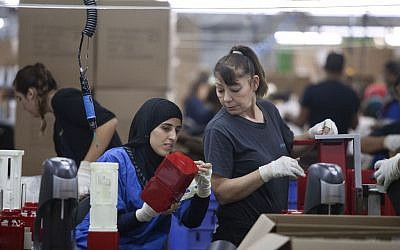 Employees work at the new SodaStream factory in Israel's Negev Desert, next to the city of Rahat, Wednesday, Sept. 2, 2015. (AP/Dan Balilty)
