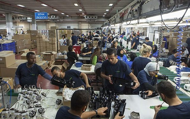 Employees work at the SodaStream factory built deep in Israel's Negev Desert next to the city of Rahat, Israel, September 2, 2015. (AP/Dan Balilty)