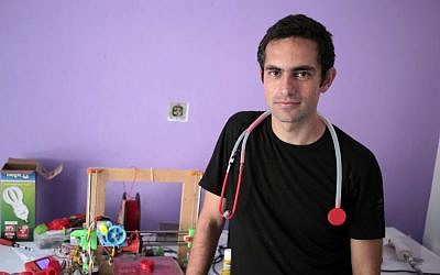 Dr. Tarek Loubani, a Palestinian-Canadian doctor, poses for a picture with 3D printed stethoscope around his neck, in Gaza City on September 7, 2014. (AP Photo/ Khalil Hamra)