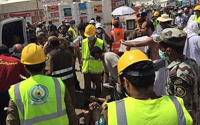 In this image posted on the official Twitter account of the directorate of the Saudi Civil Defense agency, rescuers respond to a stampede that killed and injured pilgrims in the holy city of Mina during the annual hajj pilgrimage on Thursday, Sept. 24, 2015. (Directorate of the Saudi Civil Defense agency via AP)