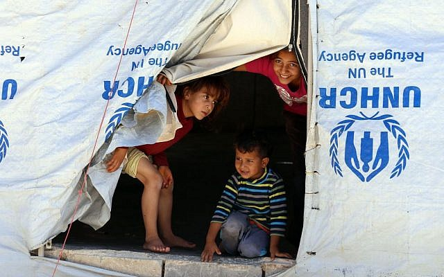 Illustrative: Syrian refugee children look from their tent during a visit by UN humanitarian chief Stephen O'Brien to the Zaatari Refugee Camp, near Mafraq, Jordan, September 19, 2015. (AP Photo/Raad Adayleh)