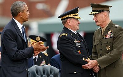 President Barack Obama watches as newly sworn-in Joint Chiefs Chairman Gen. Joseph Dunford Jr., right, shakes hands with retiring Joint Chiefs Chairman Gen. Martin Dempsey during his Armed Forces Full Honors Retirement Ceremony for Dempsey, Sept. 25, 2015, at Fort Myer in Arlington, Va. (AP Photo/Andrew Harnik)