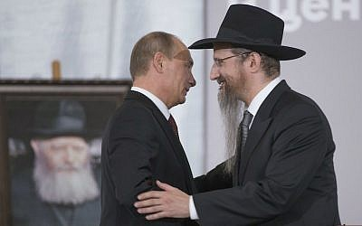 Russian President Vladimir Putin, left, is greeted by Russia's Chief Rabbi Berel Lazar in Moscow, June 13, 2013. (Alexander Zemlianichenko/AP Images/via JTA)