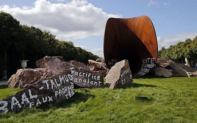 The sculpture 'Dirty Corner' by British-Indian artist Anish Kapoor in the gardens of the Palace of Versailles, near Paris was spray-painted with anti-Semitic graffiti on September 6, 2015. The French phrase in center reads: 'Bloody sacrifice' (Christophe Ena/AP)
