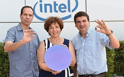 "(L) Roni Friedman and (R) Valentin Kaplan hold Skylake SoCs; (C) Shlomit Weiss holds a ""fresh from the factory"" sheet of Skylake chips (Intel)"