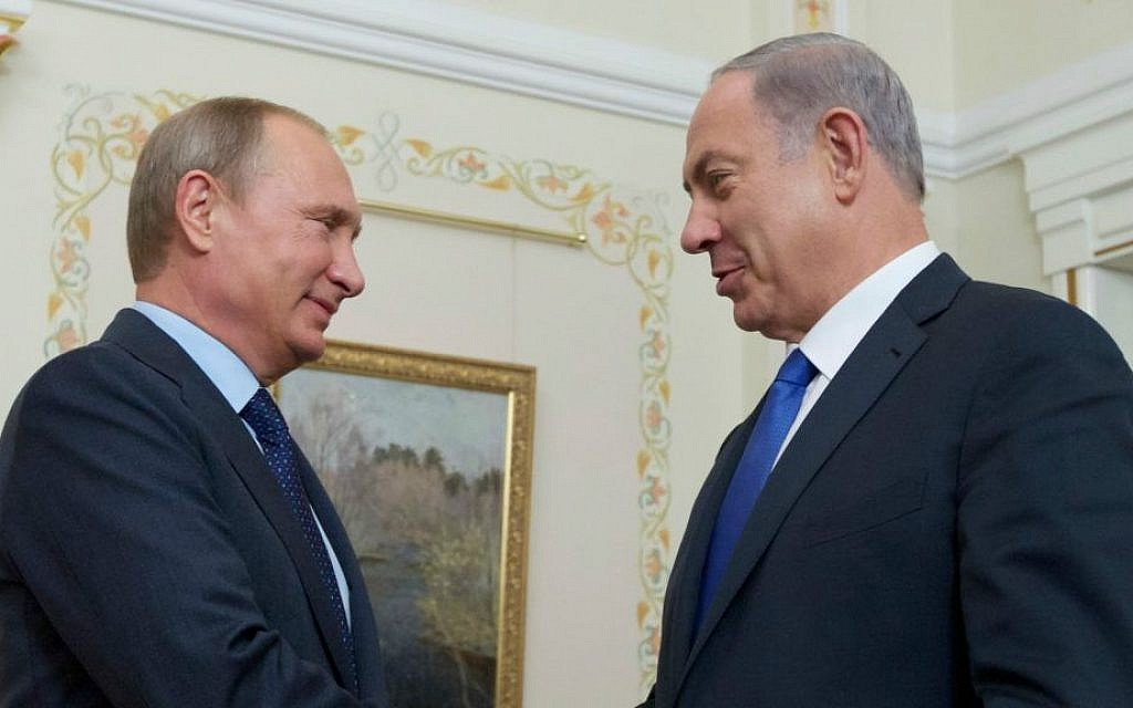 Russian President Vladimir Putin shakes hands with Prime Minister Benjamin Netanyahu, right, during their meeting in the Novo-Ogaryovo residence, outside Moscow, Russia, Monday, Sept. 21, 2015. (AP Photo/Ivan Sekretarev, Pool)