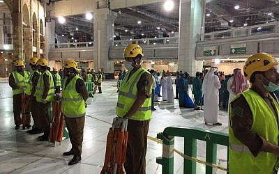 An area is cordoned off at the Grand Mosque in Mecca after a crane collapsed killing dozens, Friday, Sept. 11, 2015. The accident happened as pilgrims from around the world converged on the city, Islam's holiest site, for the annual Hajj pilgrimage, which takes place this month. (Saudi Interior Ministry General Directorate of Civil Defense via AP)