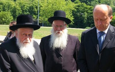 Rabbi Shaye Schlesinger, left, chairman of the Committee for the Preservation the Jewish Cemeteries in Europe, with former Lithuanian Prime Minister Andrius Kubilius, right, at a ceremony in Vilnius in June 2011. (Courtesy of the Committee for the Preservation the Jewish Cemeteries in Europe/via JTA)