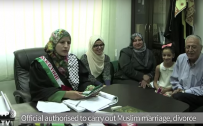 Tahrir Hammad oversees a wedding in the West Bank city of Ramallah on August 8, 2015. (screenshot: YouTube via AFP)