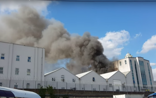 The Baitul Futuh Mosque in Morden, London engulfed in flames on September 26, 2015. (screenshot: YouTube)