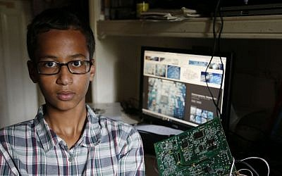 Irving MacArthur High School student Ahmed Mohamed, 14, poses for a photo at his home in Irving, Texas on Tuesday, Sept. 15, 2015. (Vernon Bryant/The Dallas Morning News via AP)