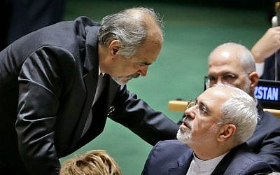 Syrian Ambassador to the United Nations Bashar Jaafari, left, talks with Iran's Foreign Minister Mohammad Javad Zarif during the 70th session of the United Nations General Assembly at UN headquarters, Monday, September 28, 2015. (AP Photo/Seth Wenig)
