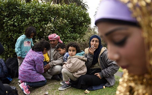Syrian refugees gather at Independence Square, in Montevideo, Uruguay, Monday, Sept. 7, 2015. (AP Photo/Matilde Campodonico)
