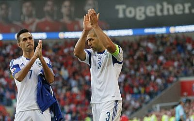 Israel's Tal Ben Haim I, right, and Eran Zahavi applaud their fans after drawing the Euro 2016 Group B qualifying match between Israel and Wales at the Cardiff City stadium in Cardiff, Wales, Sunday, September 6, 2015. (Tim Ireland/AP)