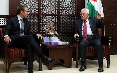 Palestinian Authority President Mahmoud Abbas (R) meets with French Economy Minister Emmanuel Macron (L) in the West Bank city of Ramallah on September 7, 2015. (AFP/ ABBAS MOMANI)
