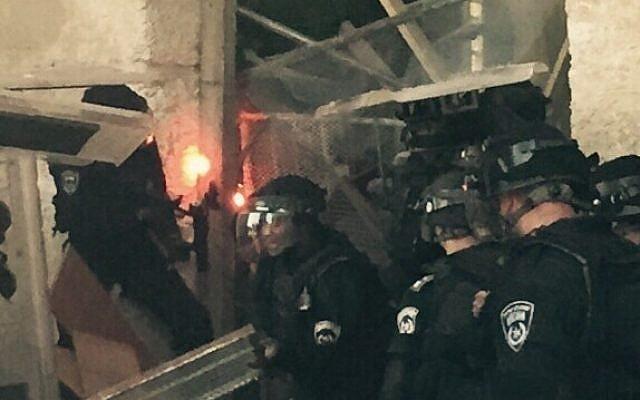 Police examine a barricade set up by Palestinians on the Temple Mount compound, Jerusalem, September 13, 2015. (Police spokesperson)