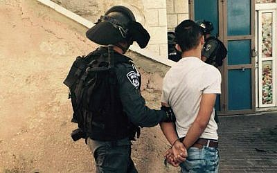 Illustrative photo of a Border Police officer arresting a Palestinian man in the Jerusalem neighborhood of Jabel Mukaber on September 18, 2015. (Israel Police)