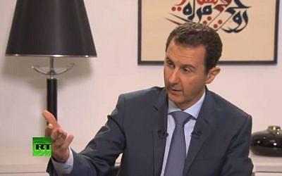 Syrian President Bashar Assad speaking to Russian media outlets RT, Rossiyskaya Gazeta, Channel 1, Russia 24, RIA Novosti and NTV channel, September 15, 2015. (Screenshot: RT)