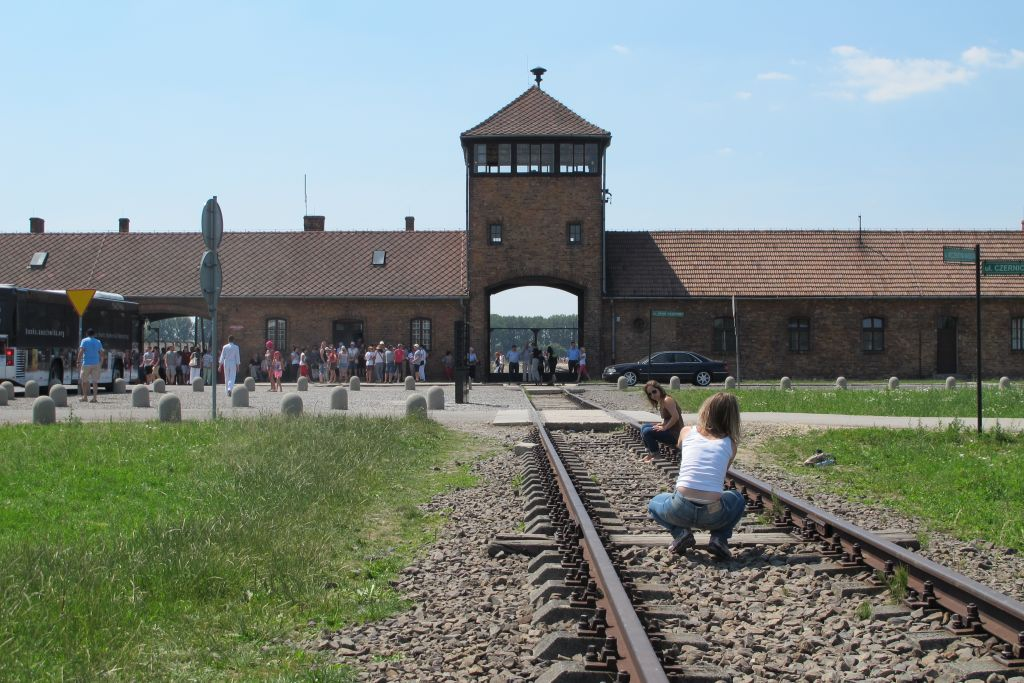 The looming tower entrance to Birkenau provides a photo opportunity, July 2015. (Ruth Ellen Gruber/JTA)