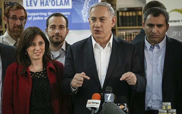 "Prime Minister Benjamin Netanyahu, MKs Tzipi Hotovely (L) and Zeev Elkin (R ) during a tour of the ""Lev HaOlam"" organization, in Jerusalem on February 3, 2015. The organization promotes the export and sale of products from Jewish settlements in the West Bank, aiming to fight a boycott of Israeli settlement products. (Hadas Parush/Flash90)"