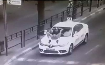Security camera footage of a disturbed man interfering with traffic in Rishon Lezion, September 8, 2015. (Facebook)