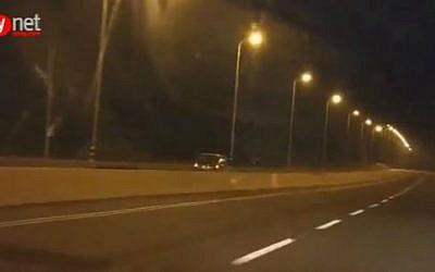 Footage of vehicle traveling against the direction of traffic on Highway 2 north of Tel Aviv, early Tuesday, September 8, 2015. (screen capture/Ynet)