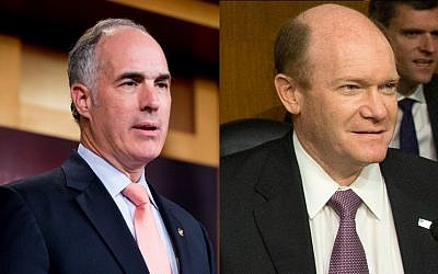 Democratic senators Bob Casey, left, and Chris Coons both expressed support for the Iran nuclear deal on September 1, 2015. (AP Photos/Andrew Harnik)