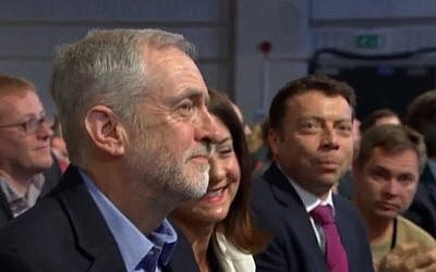 Jeremy Corbyn smiles as the results of the British Labour party leadership election show him to be the clear winner on Saturday, September 12, 2015. (screen capture)