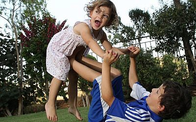 Israeli children play in a garden on a hot summer day. July, 2011. (Nati Shohat/FLASH90)