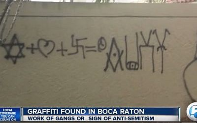 Anti-Semitic graffiti found outside a Florida complex, September 2015. (YouTube screenshot)