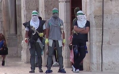 Still image taken from a video released by an Israel Police spokesman showing Palestinians gearing up for a confrontation on the Temple Mount in Jerusalem on Sunday, September 13, 2015. (screen capture: Israel Police)