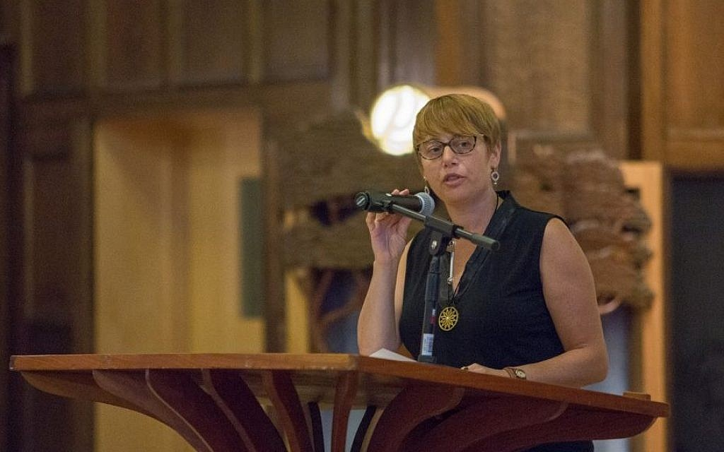 In this file photo, Idit Klein, Keshet President & CEO, addresses up to 200 attendees at a Memorial and Solidarity Gathering at Boston's Temple Israel on September 9, 2015. (Elan Kawesch/The Times of Israel)
