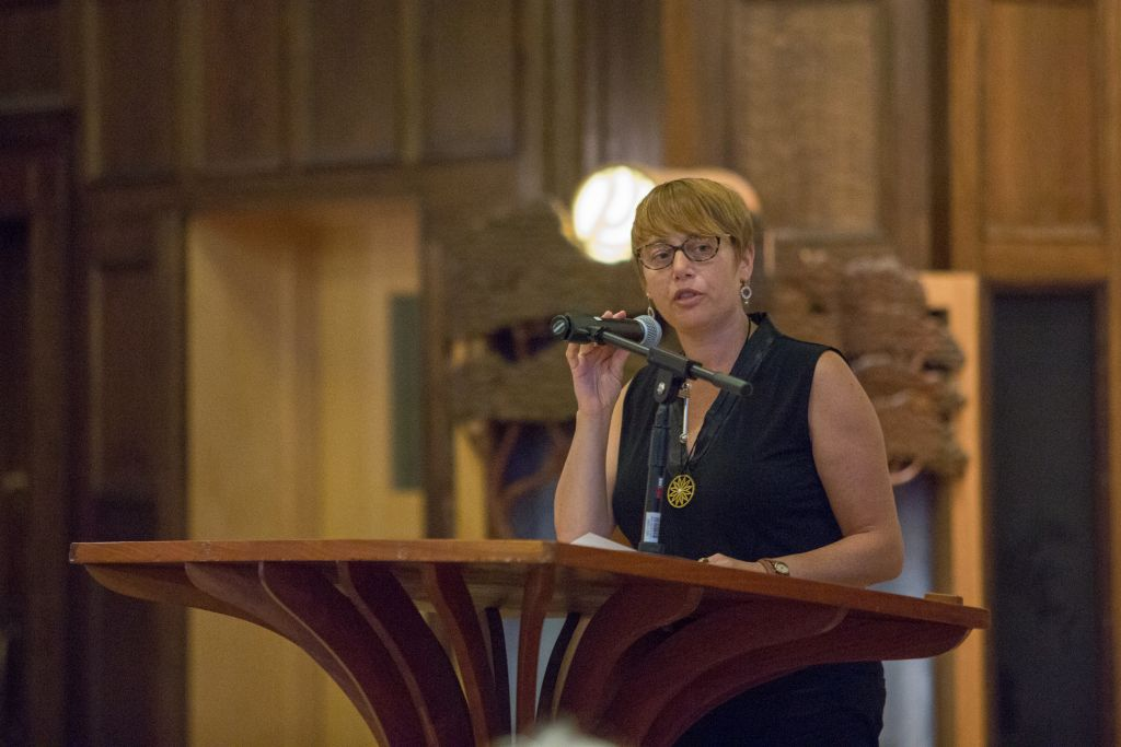 Idit Klein, executive director of the Boston-based Keshet for LGBTQ Jews and their allies, addresses up to 200 attendees at a Memorial and Solidarity Gathering at Boston's Temple Israel on September 9, 2015 (Elan Kawesch/The Times of Israel)