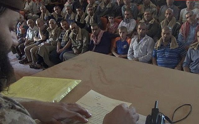 Islamic State officials are making Christians in the Syrian town of Al-Qaryatayn sign a contract for non-Muslims, in an image released September 3, 2015. (Photo credit: MEMRI)