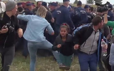 A Hungarian TV camerawoman seen kicking a child migrant during disturbances at Roszke, southern Hungary, September 8, 2015 (YouTube screen cap)