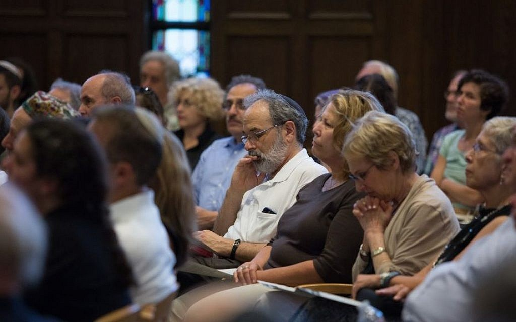 Gathered at Boston's Temple Israel on September 9, 2015, up to 200 community members held a Memorial and Solidarity Gathering for victims of violent Jewish extremism in Israel during the past summer (Elan Kawesch/The Times of Israel)