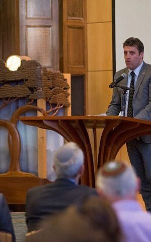 Matan Zamir, Israel's deputy counsel general to New England, addressed the audience at a September 9, 2015 Memorial and Solidarity Gathering at Boston's Temple Israel (Elan Kawesch/The Times of Israel)