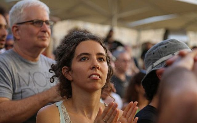 The audience watches American Jewish singer Matisyahu perform at the Sacred Music Festival in the Old City of Jerusalem, September 4, 2015. (Eric Cortellessa)