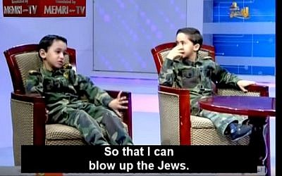 A Hamas-run TV station in Gaza interviews two young boys aspiring to wage Jihad against Israel and 'blow up the Jews.' (screen grab: YouTube)