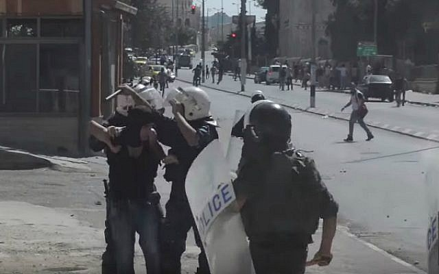 A still image from a video purporting to show Palestinian Authority security forces clashing with Palestinian protesters in the West Bank, September 18, 2015. (screen capture: YouTube)