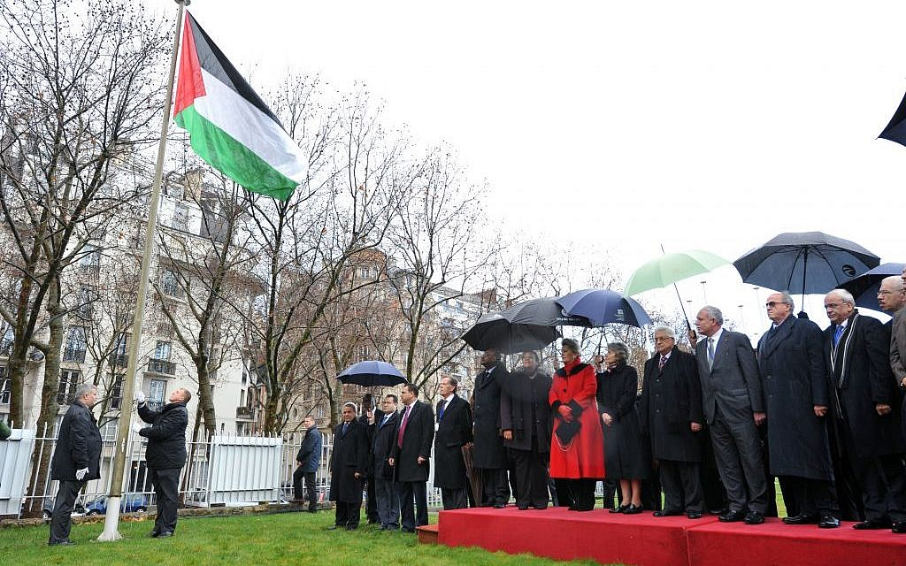 The Palestinian flag is raised outside the headquarters of the UN Educational, Scientific and Cultural Organization (UNESCO) in Paris, in a formal ceremony marking Palestine's full admission into the organization as its 195th member, in December 2011. (UN/UNESCO/Danica Bijeljac)