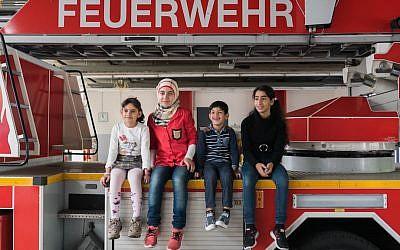 Refugee children visiting a fire station in Berlin, September 2015. (Judith Kessler)