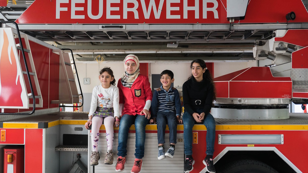 Refugee children visiting a fire station in Berlin, September 2015. (Judith Kessler)