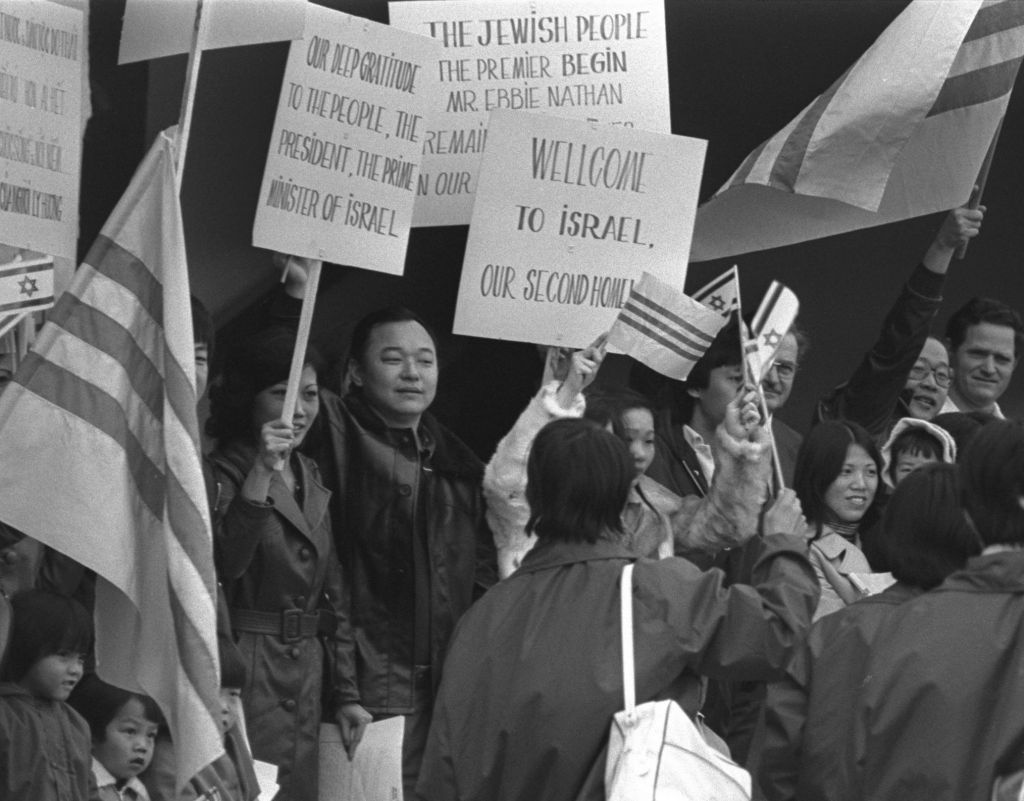 Newly arrived refugees being greeted at Ben Gurion Airport by fellow Vietnamese already in Israel, January, 1979 (Photo credit: Moshe Milner/GPO)