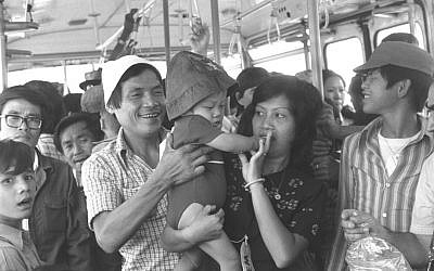 Newly arrived refugees from Vietnam ride the bus to the Ben Gurion Airport arrivals terminal, June 26, 1977 (Moshe Milner/GPO)